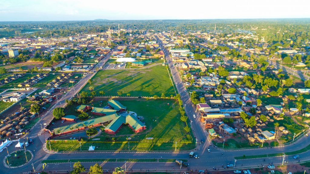 An aerial view of the roads in Gulu. The government of Uganda was able to construct five roads totaling to 3.638km at a contract sum of 16,180,000= VAT exclusive.  They include; Alokolum road, Labourline, Acholi Lane, Cemetery road and ring road. The roads constructed under phase 1(a) and 1(b) include, Kabalega road(0.160km), Adonga road(0.334km), Crane Avenu(0.195km), Philip Tarner(0.266), Odur min Odyek(0.336), Commercial road(0.364), School(0.355), Salvatore Alwoch(0.672), Opwonya Walter(0.670), Muroni(0.694), Lumumba Avenue(0.250) and Lango road(0.226).