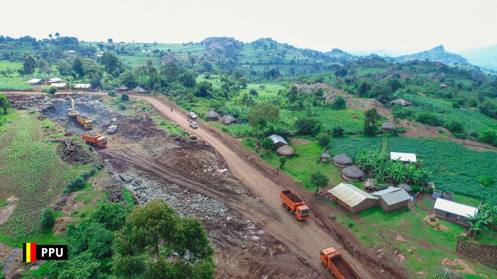 The construction works underway on the Kapchorwa-Bukwo road. The project, a multinational operation, is set to provide an important link between Uganda and Kenya by connecting the 2 countries at the border post of Suam. The project runs from Kapchorwa Town to Suam on the Uganda side while on the Kenya side, the road project will connect Suam to Kitale on to Eldoret By-pass. The road project supports the regional integration objective of member countries of East African Community (EAC) and the Great Lakes Region, especially Uganda and Kenya, thereby making connection to Suam and further linking with the Democratic Republic of Congo (DRC) and South Sudan and improve trade.  The Uganda side project is being financed by the African Development Bank (ADB) and African Development Fund (ADF) loans and the Government of Uganda's counterpart funding. The project involves the upgrading of the 73-Kms Kapchorwa-Suam section road. The 77km road project will be a game changer for this sub-region rich in agriculture and tourism potential. Don't forget cross-border trade with Kenya